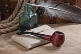 Postal parcel, tobacco pipe and inkwell — Stock Photo
