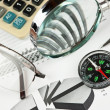 Compass and working paper - Stock Photo