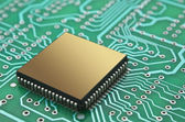Microchips on a printed circuit board — Stock Photo
