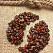 Coffee beans and rope knot on sack — Stock Photo #7935630