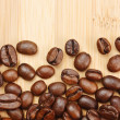Coffee beans on a wooden background — Stock Photo