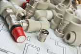 Plumbing fittings on the drawing — Stock Photo