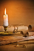 Flaming candle and antic musical notes — Stock Photo