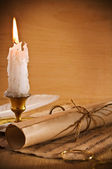 Roll of old paper andle candle — Stock Photo