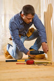 Single man work in the wooden room — Stock Photo