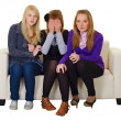Three girls look a horror movie — Stock Photo