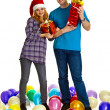 Family couple with Christmas gifts — Stock Photo #7384139