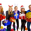 Royalty-Free Stock Photo: Friends give gifts on New Year\'s