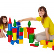 Happy mother and daughter playing with blocks — Stock Photo