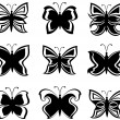 Vector illustration of a collection black and white butterflies — Stock Vector