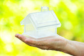 House in human hand — Stock Photo