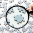 Magnifying glass and puzzle — Stock Photo #7336948