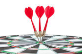 Three darts hit the dead centre of target — Stock Photo