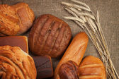 Fresh bread with ears of rye — Stock Photo