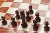 Chess strategy concept on grey background — Stock Photo