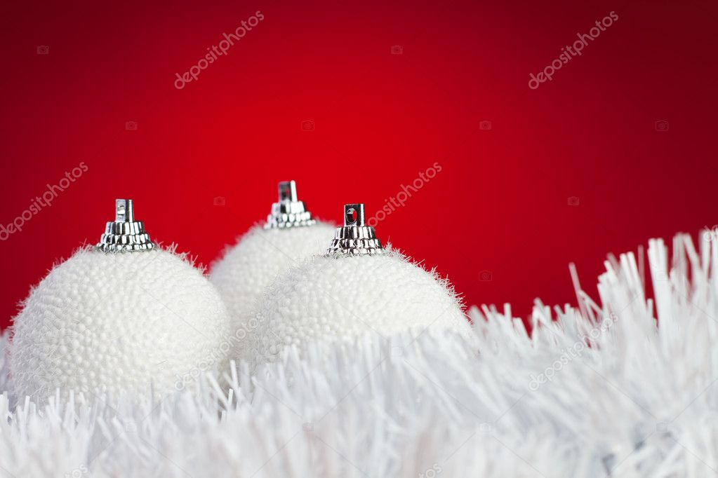 White christmas balls over bright red background — Stock Photo #7627658