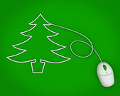 Christmas tree depicted with computer mouse cable over green — Stock Photo