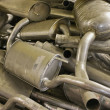 Heap of the mufflers — Stock Photo