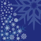 Snowflakes on a blue background. — Stock Vector