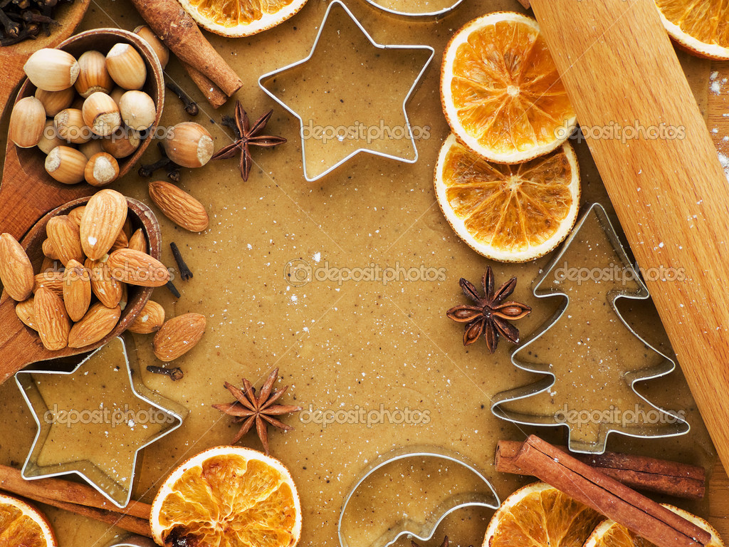 Christmas baking background dough, cookie cutters, spices and nuts. Viewed from above. — Stock Photo #7045083