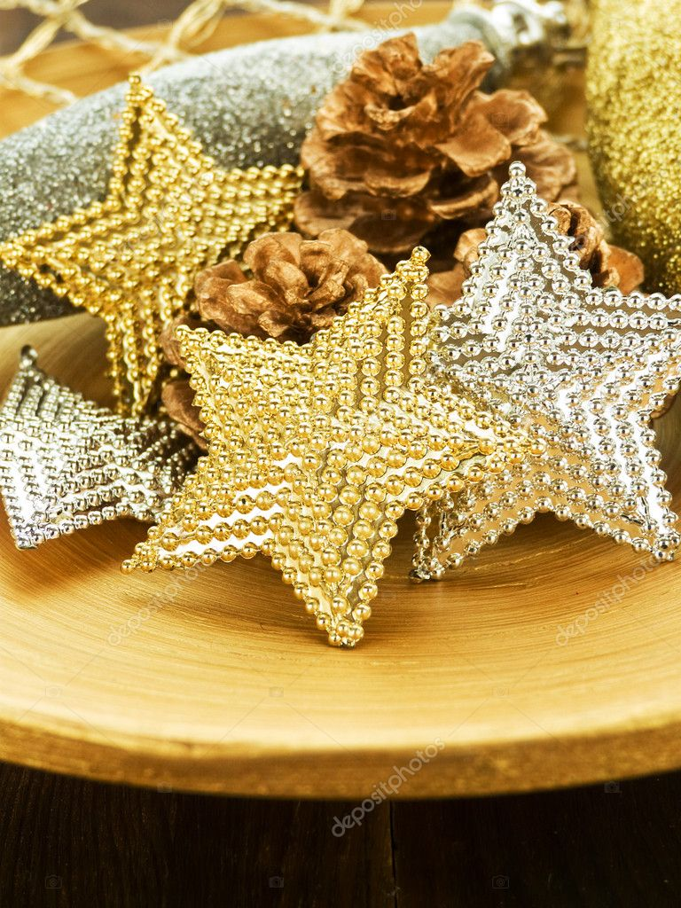 Christmas ornaments on the wooden plate. Shallow dof. — Stock Photo #7843447