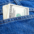 Stock Photo: Dollars in pocket