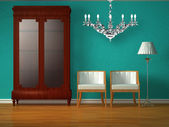 Cupboard with chairs and stand lamp with luxury chandelier — Stock Photo