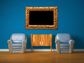 Two chairs with wooden console and modern frame in blue interior — Stock Photo