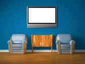 Two chairs with wooden console and lcd tv in blue interior — Stock Photo