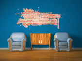 Two chairs with wooden console and splash hole in blue interior — Stock Photo