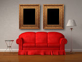 Red sofa with table and stand lamp with frames in white minimalist interior — 图库照片