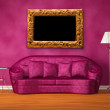Purple couch with table, standard lamp and picture frame in purple interior — Stock Photo #7633413