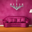 Purple couch with table, standard lamp and chandelier in purple interior — Stock Photo