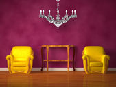 Two chairs with wooden console and luxurious chandelier in purple interior — Stock Photo