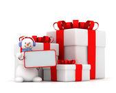 Schneemann und drei geschenk-boxen mit bändern — Stockfoto