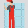 Man tiling a wall in the room — Stock Photo