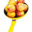 Royalty-Free Stock Photo: Yellow pan with apples