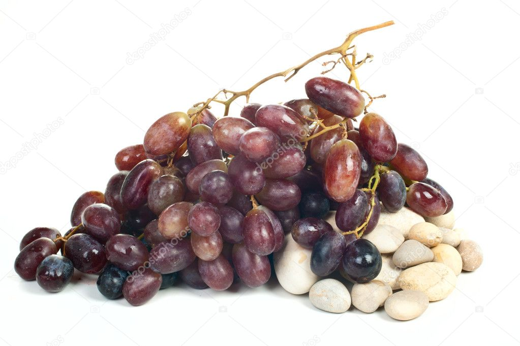 Grape on a stones isolated on blue background — Stock Photo #6921947