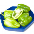 Green peppers on a blue plate — Foto de Stock