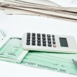 Checkbook, pen and calculator - Stock Photo