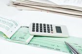 Checkbook, pen and calculator — Stock Photo