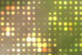 Background with out of focus light dots in green — Stock Photo