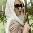 Woman in a white scarf — Stock Photo