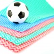 Royalty-Free Stock Photo: Football on the color napkins