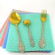 Old fork and spoons on the color napkins — Stock Photo #7508301