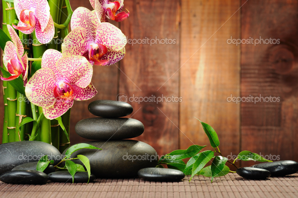 Zen basalt stones and orchid on the wood — Foto Stock #6891458