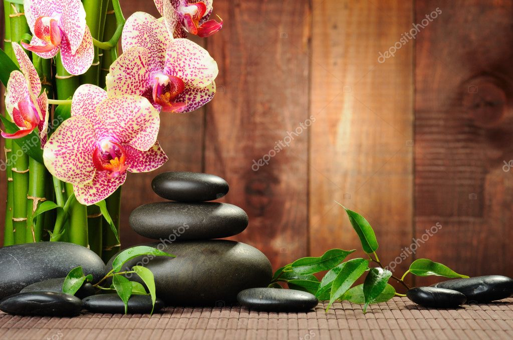 Zen basalt stones and orchid on the wood — Lizenzfreies Foto #6891458