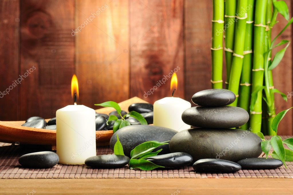 Zen basalt stones and bamboo on the wood — Foto Stock #6891635