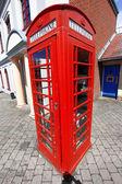 Red telephone box in London, UK — Stock Photo