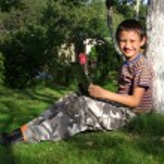 Boy on laptop outdoor — Stock Photo #6928374